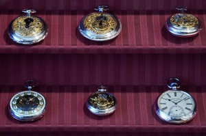 Antique Pocket Watches on Display in a Well-Kept DisplayCase