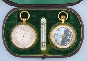 An antique barometer and compass travelling set in a green velvet box from Antique-watch.com