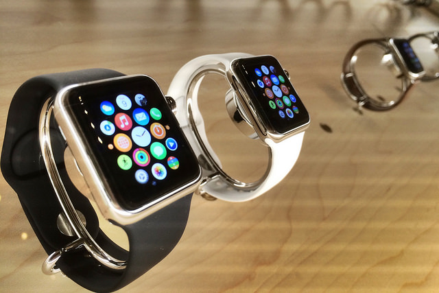 A collection of Apple Watches on a shelf in a shop near our antique pocket watches in London.