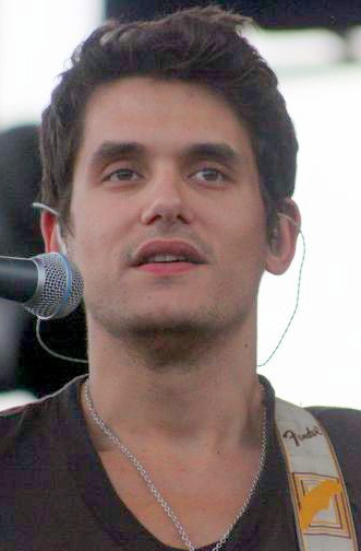 John Mayer at the Mile High Music Festival accompanied by his antique wrist watches Pieces of Time.