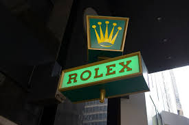 A Rolex sign outside a shop that sells these vintage watches like the antique wrist watches at Pieces of Time.
