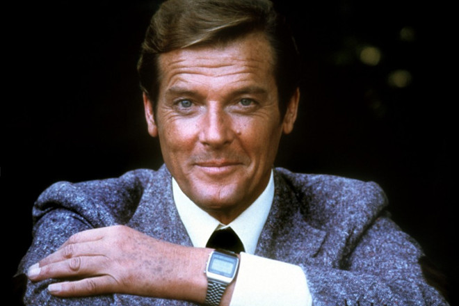 Roger Moore, the actor who played James Bond wearing an antique wrist watch