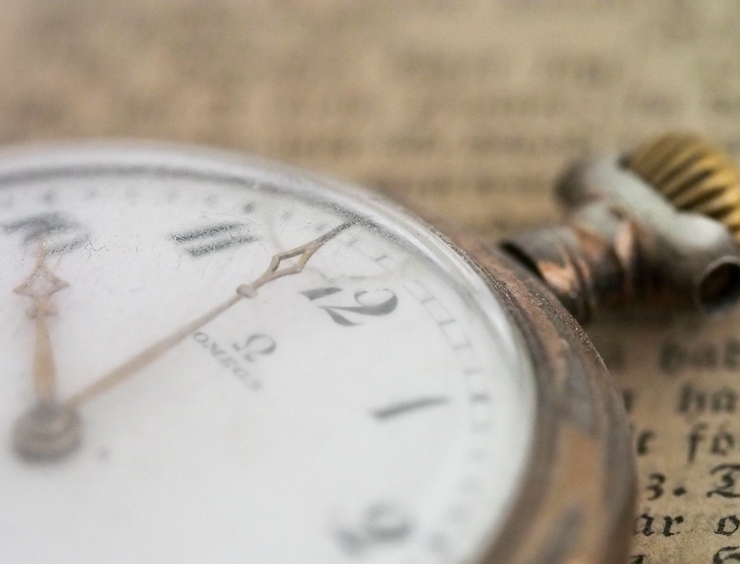 A close up of an antique pocket watch -Pieces of Time