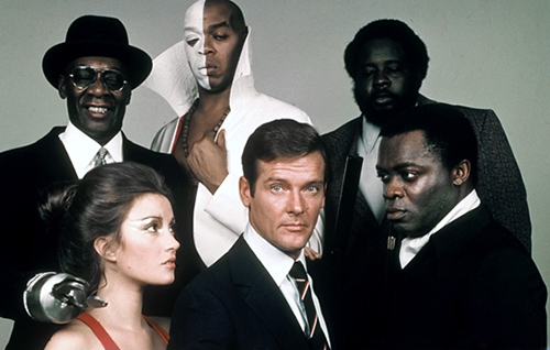 An image of the James Bond cast from Live and Let Die, near Pieces of Time