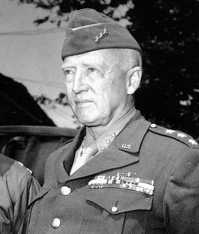A black and white image of Gen. George S. Patton wearing an antique pocket watch for sale