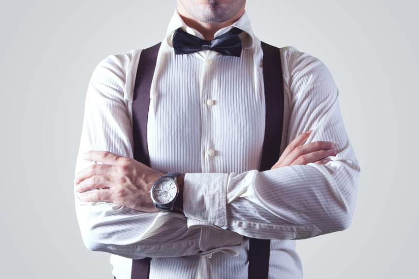 A man in a bow tie wearing a status watch like those at Pieces of Time