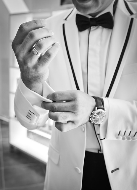 A black and white image of a man in a dinner jacket wearing a vintage watch from Pieces of Time