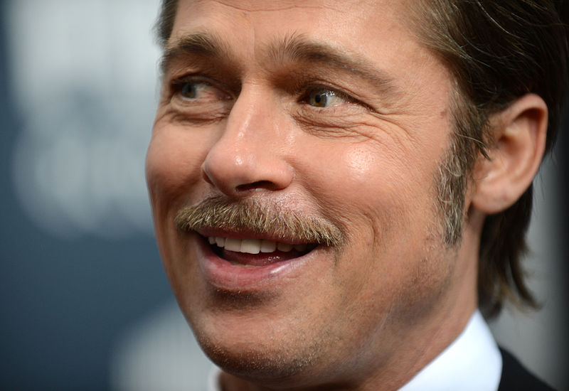 Brad Pitt pictured before breaking world auction record fee for a wristwatch.