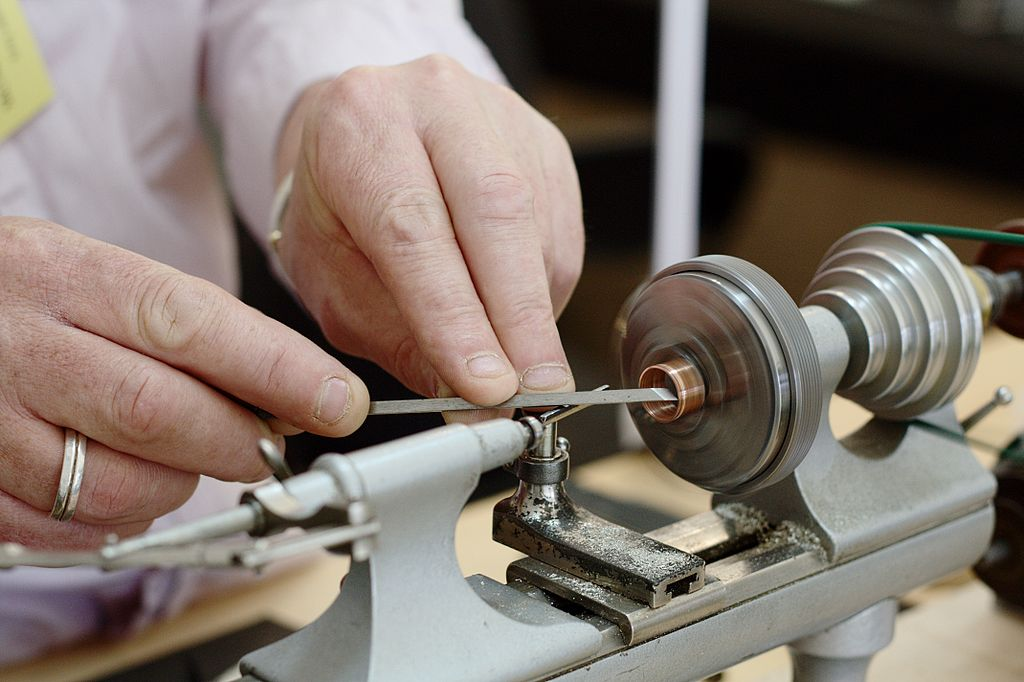 A close up of a watch maker making a watch similar to antique watches for sale in the UK