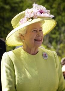 Queen Elizabeth II enjoying the sun near Pieces of Time on London.