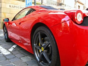 A red Ferrari that costs less than a Patek Philippe antique pocket watch