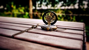 An open pocket watch on a bench near Pieces of Time