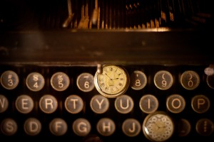 Two antique pocket watches on top of a vintage typewriter at Pieces of Time