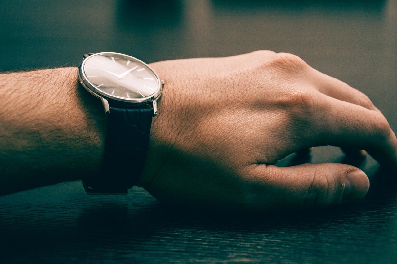 antique watch on man's wrist.