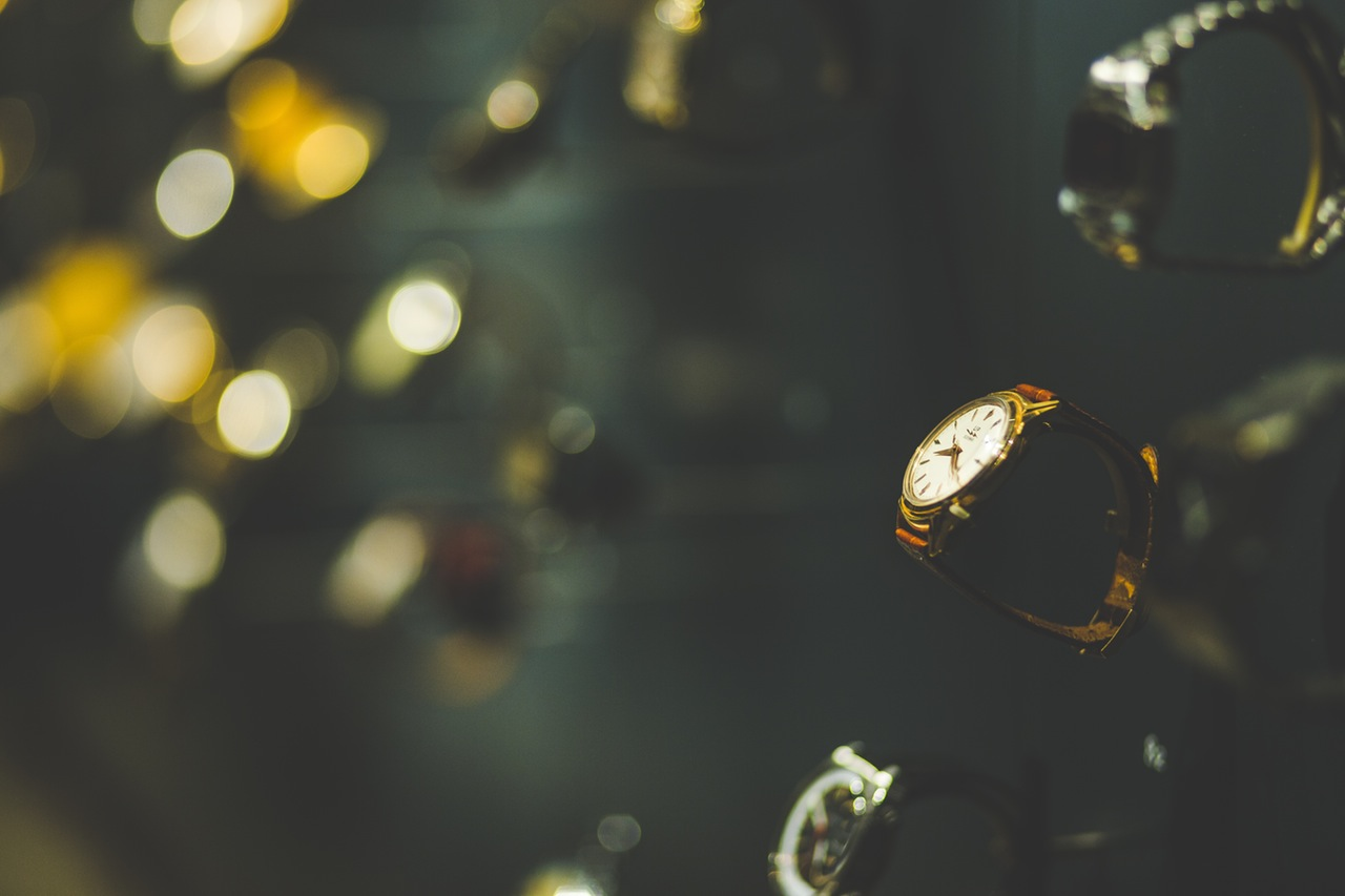 Antique watches to buy, displayed in shop window.